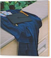 Graduation Gown With Mortarboard On Retaining Wall Wood Print