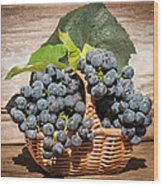 Grapes And Leaves In Basket Wood Print by Len Romanick