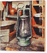Green Hurricane Lamp In General Store Wood Print