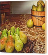Green Pears In Rustic Basket Wood Print by Olivier Le Queinec