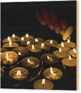 Hand Lighting Candles Wood Print