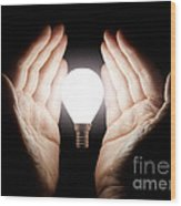 Hands Holding Light Bulb Wood Print