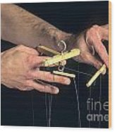 Hands Of A Puppeteer Wood Print by Bernard Jaubert