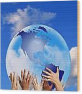 Hands Touching A Globe Wood Print by Don Hammond