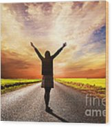 Happy Woman Standing On Long Road At Sunset Wood Print