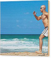 Healthy Man Running On The Beach Wood Print