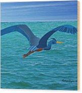 Heron Flying Over Ocean Wood Print