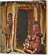 Himba Family By The Door Of Their Clay Hut Wood Print by Paul W Sharpe Aka Wizard of Wonders