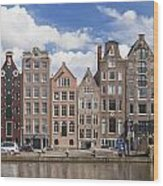 Historic Buildings Along The Damrak Canal In Amsterdam Wood Print