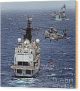 Hms Cornwall Is Pictured Receiving Stores By Merlin Helicopter  Wood Print