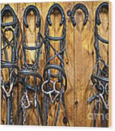 Horse Bridles Hanging In Stable Wood Print