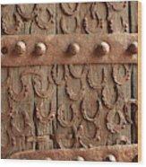 Horseshoes Decorate A Wooden Door, Jama Wood Print