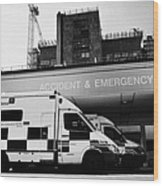 hospital accident and emergency entrance with ambulances London England UK Wood Print