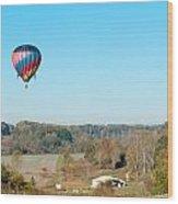 Hot Air Balloon Over Farm Land Wood Print