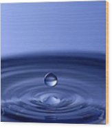 Hovering Blue Water Drop Wood Print by Anthony Sacco