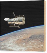 Hubble  Telescope  In  Orbit  Above  Earth Wood Print