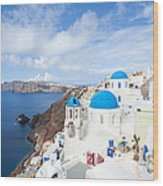 Iconic Blue Domed Churches In Oia Santorini Greece Wood Print by Matteo Colombo