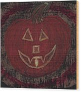 Jack O Lantern Set On A Dark Background With Glowing Flame Wood Print