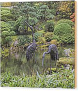 Japanese Bronze Cranes Sculpture By Pond Wood Print