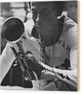 Jazz Musician Miles Davis Looking At His Trumpet Wood Print