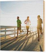 Jogging Along The Coast Wood Print