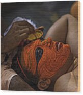 Kerala - A Theyyam-dancer Receives The Ornamental Face-painting Wood Print