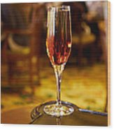 Kir Royale In A Champagne Glass Wood Print