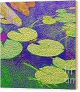 Koi Fish Under The Lilly Pads  Wood Print by Jon Neidert