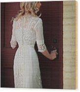 Lady In Edwardian Dress Opening A Door Wood Print