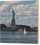 Lady Liberty With Sailboat And Water Taxi Wood Print