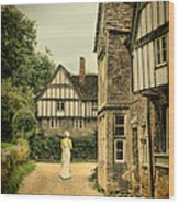 Lady Walking In The Village Wood Print by Jill Battaglia