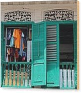 Laundry Hanging Seen Through Open Wood Shutter Windows Singapore Wood Print