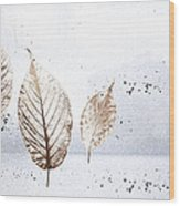 Leaves In Snow Wood Print