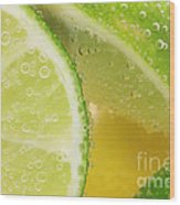 Lemon And Lime Slices In Water Wood Print