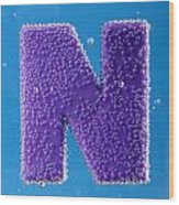 letter N underwater with bubbles  Wood Print