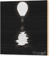 Light Bulb Shining With Reflection In Water On Black Wood Print