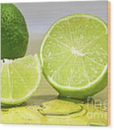 Limes On Yellow Surface Wood Print