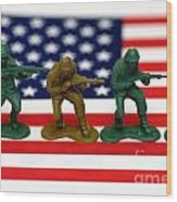 Line Of Toy Soldiers On American Flag Shallow Depth Of Field Wood Print by Amy Cicconi