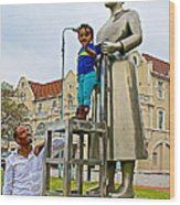 Little Girl Gets Close To Woman Sculpture In Donkin Reserve In Port Elizabeth-south Africa Wood Print