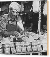 Local Arab Man Measuring Out A Quantity Of Spice For Sale On Stall Of Spices At The Market In Nabeul Tunisia Wood Print by Joe Fox