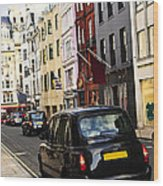 London Taxi On Shopping Street Wood Print