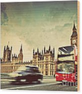 London The Uk Red Bus Taxi Cab In Motion And Big Ben Wood Print