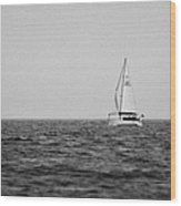 lone yacht off Rathlin Island against grey sky with sea County Antrim Northern Ireland Wood Print