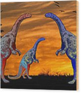 Long Necked Long Tailed Family Of Dinosaurs At Sunset Wood Print