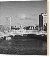 Looking Down The Liffey Towards The Hapenny Ha Penny Bridge Over The River Liffey In Dublin Wood Print by Joe Fox