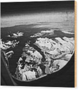 Looking Out Of Aircraft Window Over Snow Covered Fjords And Coastline Of Norway  Wood Print by Joe Fox