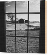 looking out through door window to snow covered scene in small rural village of Forget Wood Print