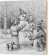 Making A Snowman Wood Print