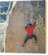 Man Bouldering On An Overhang Wood Print