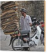Man Carrying Cardboard On The Back Of His Scooter Wood Print